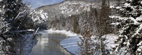 Winter view of a river with hills in background