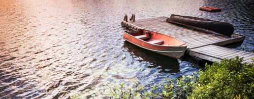 floating dock with boat tied to side