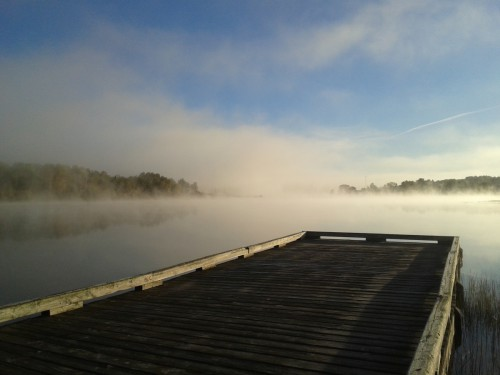 Floating dock on a foggy lake