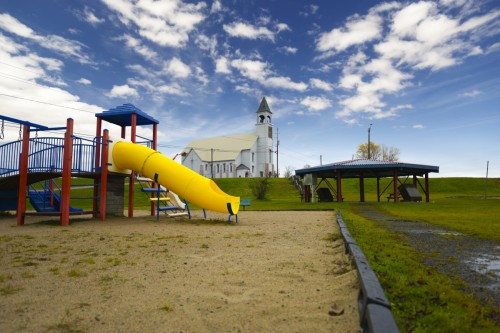 Kid's playground with church in the background