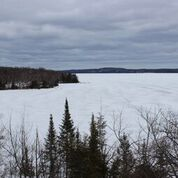 Frozen and snow covered lake in the wintertime