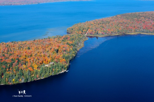 Aerial View of fall foliage and a large body of water