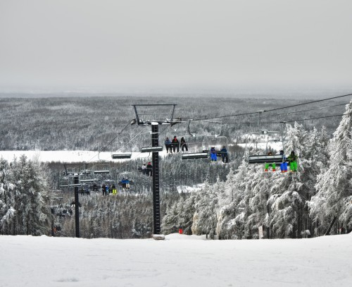 Skiers and Snowboarders on the Chairlift at kamiskotia Ski Hill